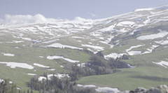 Snow and grass on the sloping surface of a mountain plateau Lagonaki Stock Footage