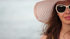 beautiful woman in sunglasses and hat - stock footage