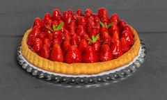 Strawberry cake with mint leaves on a anthracite wood - stock photo
