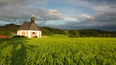 Renovated church on the edge of a cornfield at sunset Stock Footage