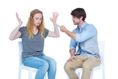 Sitting couple having an argument Stock Photos