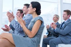 Business people applauding during meeting Stock Photos