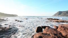 Porto Ferro rocky shore on a clear day Stock Footage
