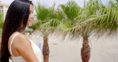 Brunette Woman Smiling at Camera on Tropical Beach Stock Footage