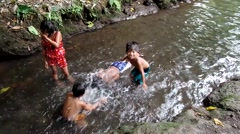 Children bathe in river Stock Footage