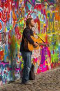 Prague Street Busker Performing Beatles Songs at John Lennon Wall Stock Photos