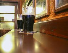 Two dark Irish stout beers - stock photo