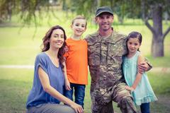 Handsome soldier reunited with family - stock photo