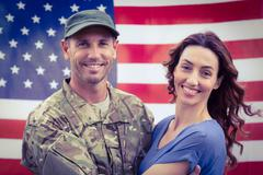 Handsome soldier reunited with partne - stock photo