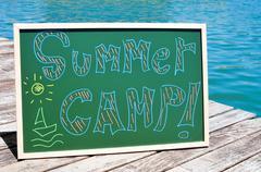 text summer camp written in a chalkboard - stock photo