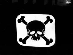 "Sign ""danger of death"" skull and crossbones, reversed - stock photo"
