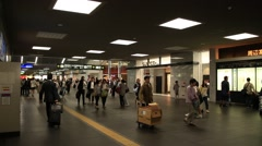 People walking on hall way of Kyoto train station - stock footage