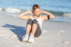 Fit woman doing sit up - stock photo