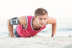Stock Photo of Handsome man doing push ups