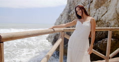 Lady Holding at Beach Railing with Air Blown Hair Stock Footage