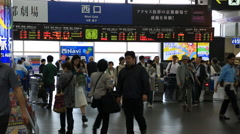 People walking around the fare gate of Kyoto train station  Stock Footage