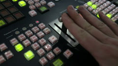 Stock Video Footage of Director broadcast video mixer operation still shot
