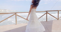 Playful Lady in White Enjoying at Beach Pathway Stock Footage