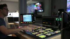 Broadcast Director controls video mixer track left Stock Footage
