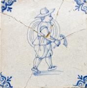 Dutch farmer wearing clothes of 17th century with small scythe in hand Stock Photos
