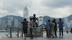 Tourists admire statue of Bruce Lee in Hong Kong 4K Stock Footage