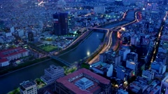 Ho Chi Minh City- April 2015: City aerial view with traffic from day to night.4K Stock Footage
