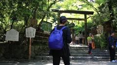 Woman walking into the shrine of Arashiyama Stock Footage