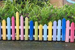 Colourful wood fence in small garden Stock Photos