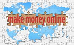 make money online word with reveal jigsaw - stock photo