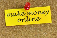 make money online word on notepaper with cork background - stock photo