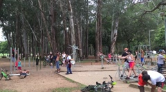 People enjoy the day at Ibirapuera Park in Sao Paulo, Brazil. Stock Footage