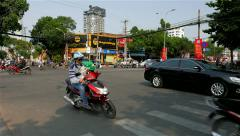 Ho Chi Minh City - April 2015: City traffic on junction with traffic lights. 4K Stock Footage