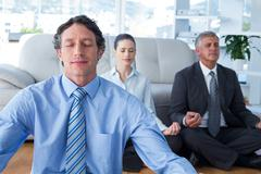Business people practicing yoga Stock Photos