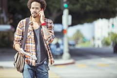 Stock Photo of Man talking on cell phone in urban crosswalk