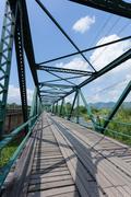 iron bridge at pai river in thailand - stock photo