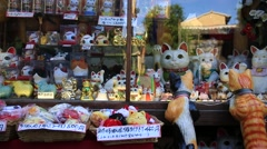 Maneki-Neko, Japanese famous souvenir cat doll at Higashiyama Stock Footage