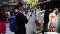 Woman picking up a travel brochure at Higashiyama Stock Footage