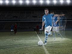 Stock Photo of Soccer player approaching ball on field