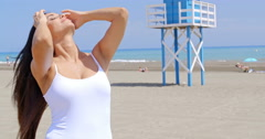 Brunette Woman Posing in front of Life Guard Stand Stock Footage
