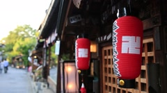 Red lanterns hanging and swaying around Higashiyama Stock Footage