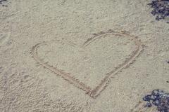 A sandy heart Stock Photos