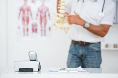 Stock Photo of Doctor showing anatomical spine