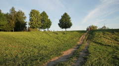 Children ride a bike from a hill in countryside Stock Footage
