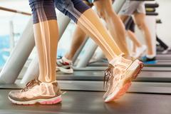 Stock Photo of Highlighted ankle of woman on treadmill