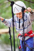 Happy active boy in rope park Stock Photos