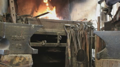 Fire In A Forge Furnace with lots of metal Stock Footage