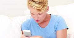 Pretty blonde getting a shocking text Stock Footage