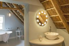 Luxury attic bathroom Stock Photos
