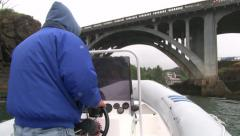 Person Driving Boat Under Bridge - stock footage