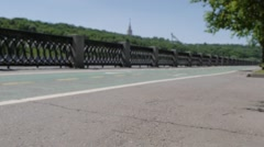 Unidentified girl cycle and roller skates near Gorky Park on may. 31, 2015 in Stock Footage